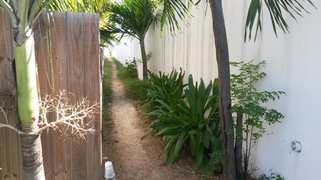 narrow-public-access-to-Oyster-Bay-Beach-borders-to-where-Coral-Beach-Club-built-condo-units-on-the-beach.jpg