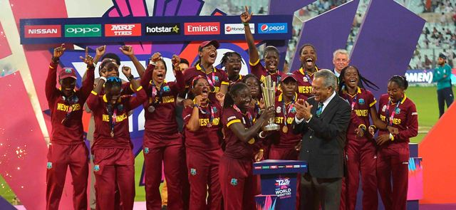 Stafanie-Taylor-holds-aloft-the-Womens-World-T20-trophy-watched-by-ICC-President-Zaheer-Abbas.jpg