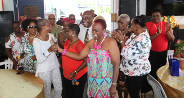 Caption: TelEm Group retiree, Stanley David, is surrounded by his wife Catherine and former colleagues from Landsradio and TelEm Group, during one stage of Friday's celebratory event.