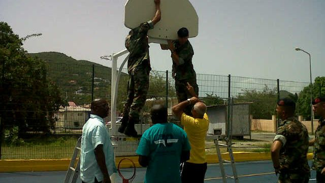 Basketball-field-backboard-in-St-Peters-being-installed.jpg