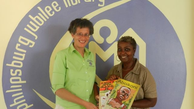 Hilli_Arduin_presenting_childrens_books_to_Library_Director.JPG