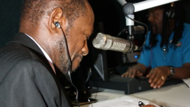 PM_Douglas_lists_questions_from_callers_on_Freedom_FM.jpg